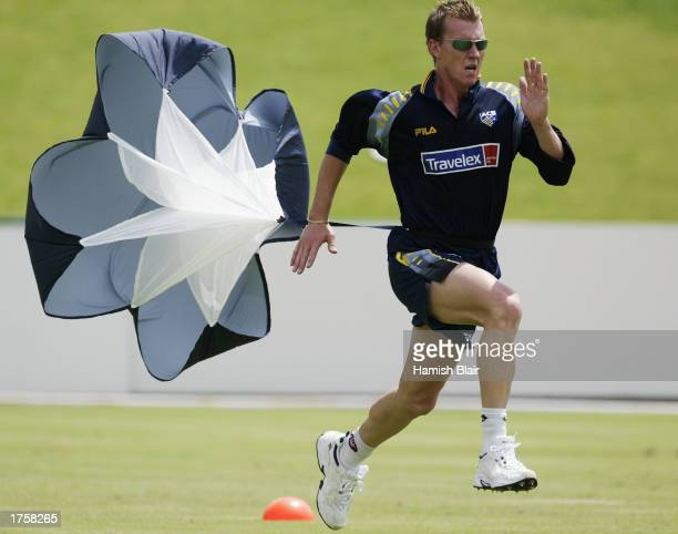 Brett Lee of Australia runs with a parachute, during training at North West Stadium, Potchefstroom, South Africa, on February 3, 2003.