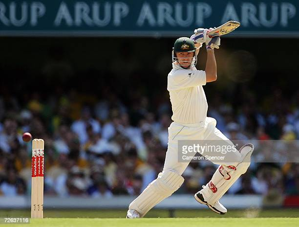Brett Lee of Australia square drives during day two of the first Ashes Test Match between Australia and England at The Gabba on November 24 2006 in...