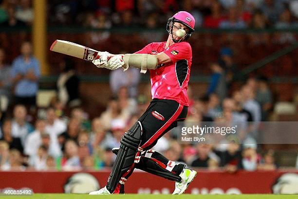 Brett Lee of the Sixers bats during the Big Bash League match between the Sydney Sixers and the Perth Scorchers at Sydney Cricket Ground on December...