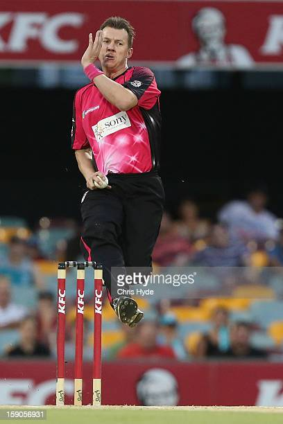 Brett Lee of the Sixers bowls during the Big Bash League match between the Brisbane Heat and the Sydney Sixers at The Gabba on January 7 2013 in...