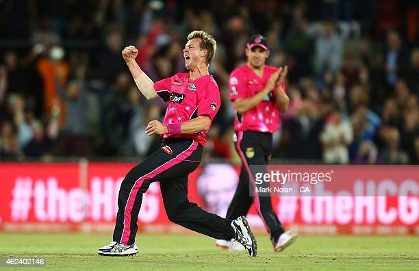 Brett Lee of the Sixers celebrates getting the wicket of Sam Whiteman of the Scorchers during the Big Bash League final match between the Sydney...