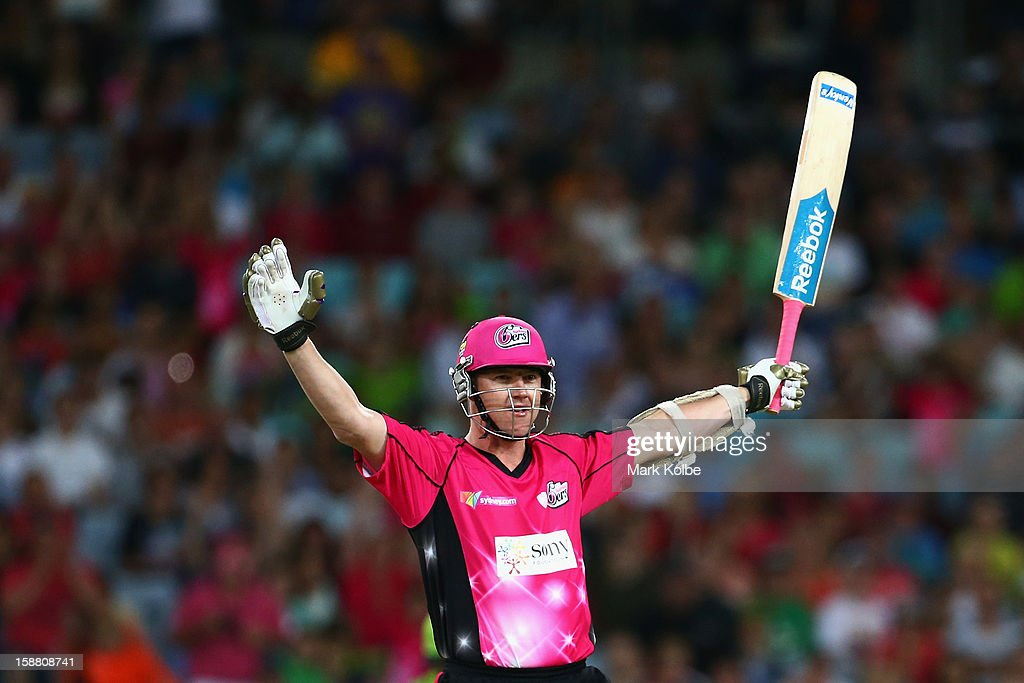 Brett Lee of the Sixers celebrates hitting the winning runs during the Big Bash League match between Sydney Thunder and the Sydney Sixers at ANZ Stadium on December 30, 2012 in Sydney, Australia.