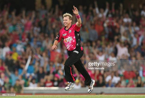 Brett Lee of the Sixers celebrates taking the wicket of Ben Laughlin of the Hurricanes during the Big Bash League match between the Sydney Sixers and...