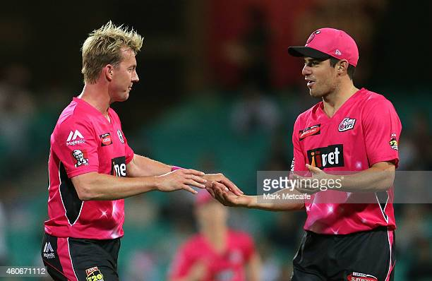 Brett Lee of the Sixers celebrates taking the wicket of Nathan Rimmington of the Renegades with team mate Moises Henriques during the Big Bash League...