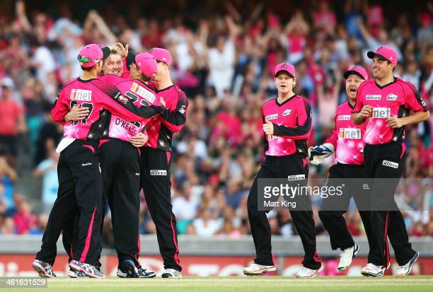 Brett Lee of the Sixers celebrates with team mates after taking the wicket of Craig Simmons of the Scorchers during the Big Bash League match between...