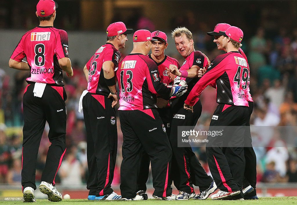 Brett Lee of the Sixers celebrates with team mates after taking the wicket of Ben Laughlin of the Hurricanes during the Big Bash League match between the Sydney Sixers and the Hobart Hurricanes at SCG on January 15, 2014 in Sydney, Australia.