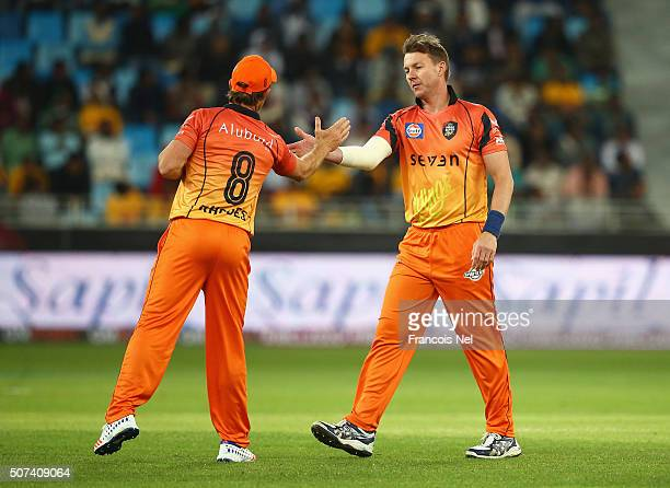 Brett Lee of Virgo Super Kings shakes hands with Jonty Rhodes after dismissing Jonathan Trott of Sagittarius Strikers during the Oxigen Masters...