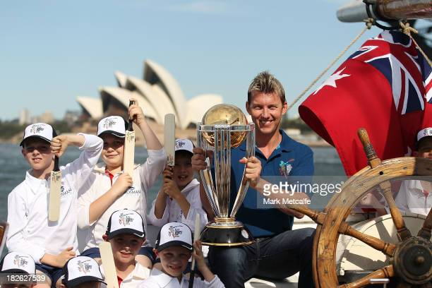 Brett Lee poses on Sydney Harbour with the ICC Cricket World Cup trophy and junior cricketers from Mosman cricket club during celebrations to mark...