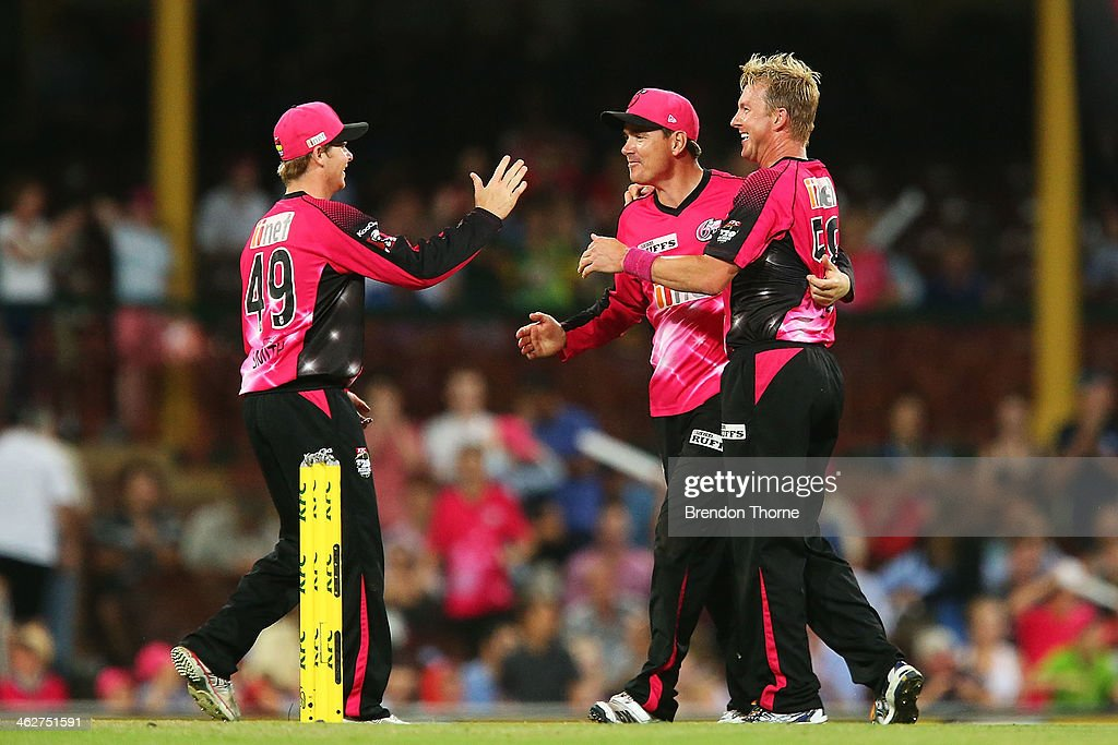 Brett Lee, Steve Smith and Marcus North of the Sixers celebrate victory over the Hurricanes during the Big Bash League match between the Sydney Sixers and the Hobart Hurricanes at SCG on January 15, 2014 in Sydney, Australia.