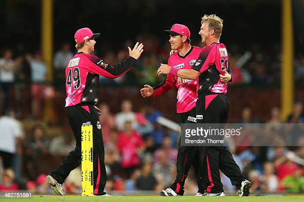 Brett Lee Steve Smith and Marcus North of the Sixers celebrate victory over the Hurricanes during the Big Bash League match between the Sydney Sixers...