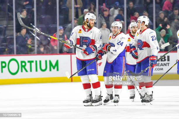 Brett Lernout of the Laval Rocket Daniel Audette of the Laval Rocke Alexandre Alain of the Laval Rocket and Victor Mete of the Laval Rocket smile...