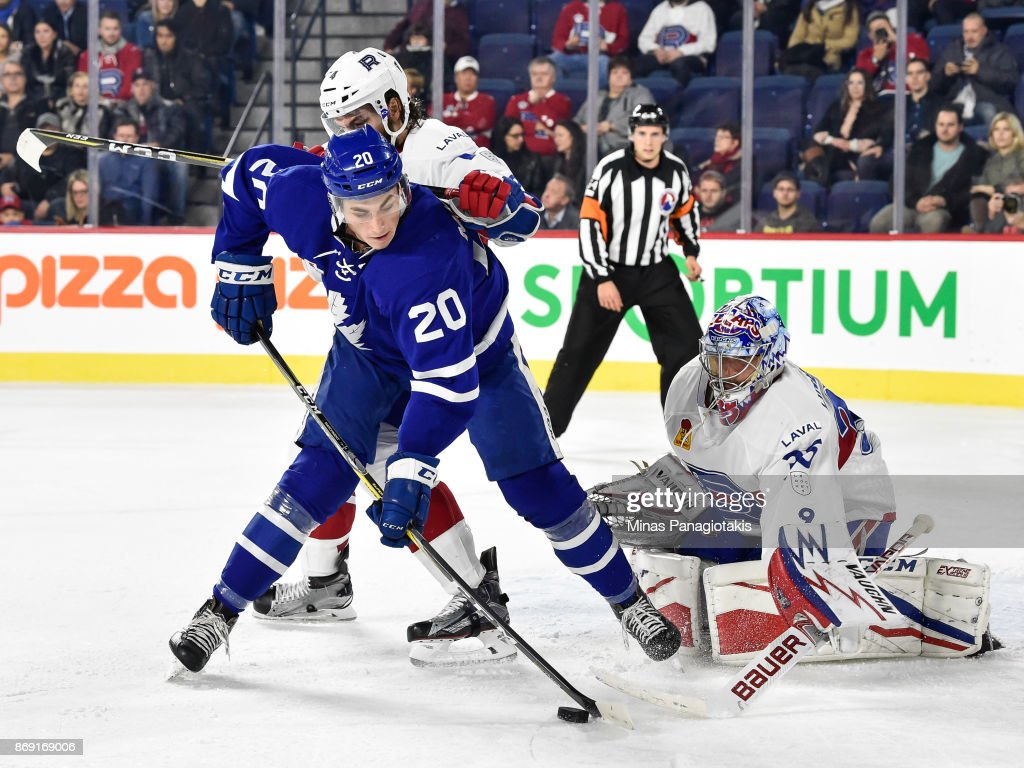 Brett Lernout #14 of the Laval Rocket defends against Michael Paliotta #2 of the Toronto Marlies while goaltender Charlie Lindgren #35 protects his net during the AHL game at Place Bell on November 1, 2017 in Laval, Quebec, Canada.
