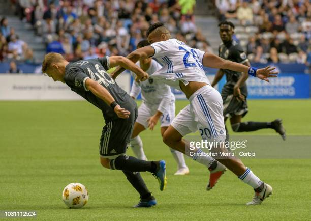 Brett Levis of the Vancouver Whitecaps and Anibal Godoy of the San Jose Earthquakes fight for the ball at BC Place on September 1 2018 in Vancouver...