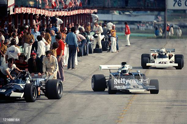 Brett Lunger leaves the Road America pit lane in his Lola T300 for the Formula 5000 race held July 16 1972 at Elkhart Lake Wisconsin