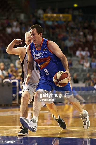 Brett Maher drives past Andrew Gaze during the NBL All Star game featured before the round 19 NBL match between the Adelaide 36ers and the New...