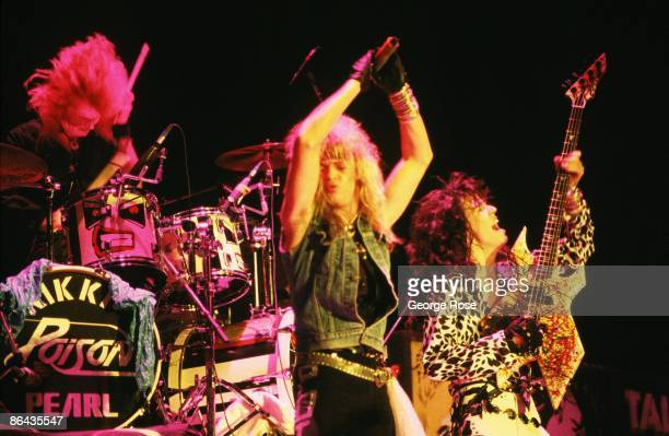 Brett Michaels lead singer for the 'big hair' metal rock band Poison and guitarist Bobby Dall prance on stage during a 1987 Long Beach California...