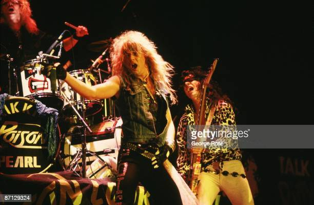 Brett Michaels lead singer for the big hair metal rock band Poison and guitarist Bobby Dall prance on stage during a 1987 Long Beach California...