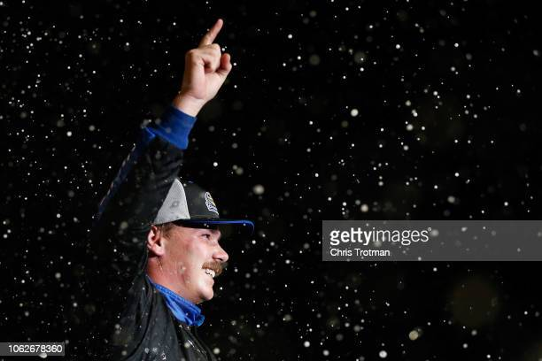 Brett Moffitt driver of the AISIN Group Toyota celebrates in victory lane after winning the NASCAR Camping World Truck Series Ford EcoBoost 200 and...