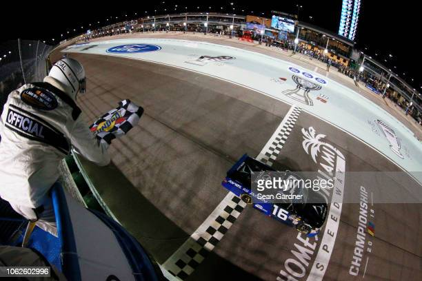 Brett Moffitt driver of the AISIN Group Toyota crosses the finish line to win the NASCAR Camping World Truck Series Ford EcoBoost 200 at...