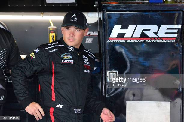 Brett Moffitt driver of the AISIN Group Toyota looks on from the garage during practice for the NASCAR Camping World Truck Series Villa Lighting...