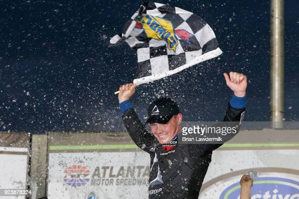Brett Moffitt driver of the AISIN Toyota celebrates in Victory Lane after winning the NASCAR Camping World Truck Series Active Pest Control 200 at...