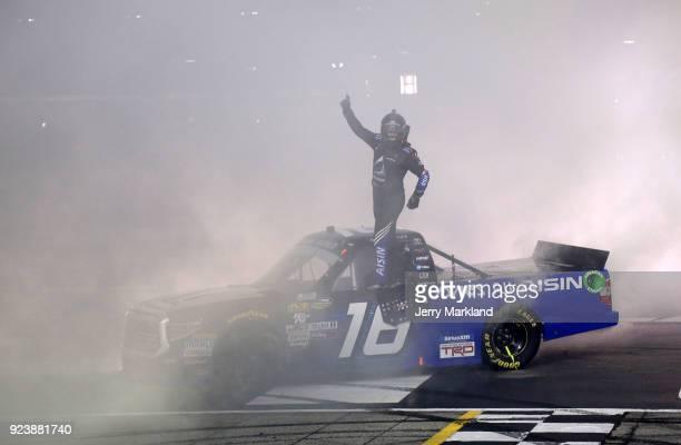 Brett Moffitt driver of the AISIN Toyota celebrates winning the NASCAR Camping World Truck Series Active Pest Control 200 at Atlanta Motor Speedway...
