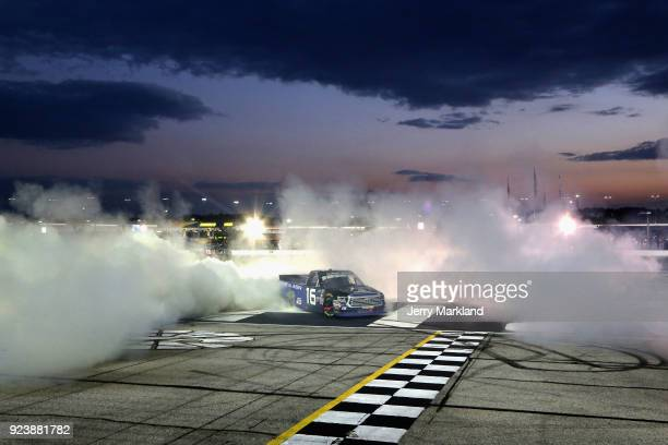 Brett Moffitt driver of the AISIN Toyota celebrates with a burnout after winning the NASCAR Camping World Truck Series Active Pest Control 200 at...
