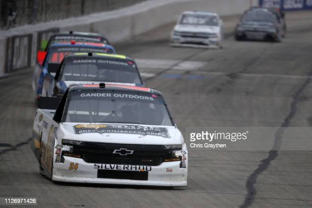Brett Moffitt driver of the Chevrolet leads a pack of cars during the NASCAR Gander Outdoors Truck Series Ultimate Tailgating 200 at Atlanta Motor...