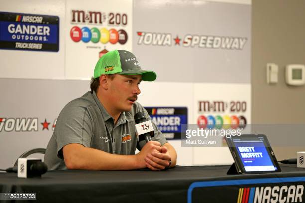 Brett Moffitt, driver of the Destiny Homes Smart Series Chevrolet, speaks during a press conference after being declared the winner of the NASCAR...