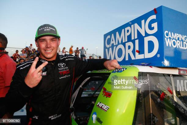 Brett Moffitt driver of the Destiny Homes Toyota applies the winner's sticker after the NASCAR Camping World Truck Series MM's 200 presented by...