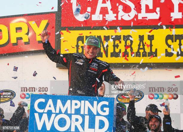 Brett Moffitt driver of the Destiny Homes Toyota celebrates in Victory Lane after winning the NASCAR Camping World Truck Series MM's 200 presented by...