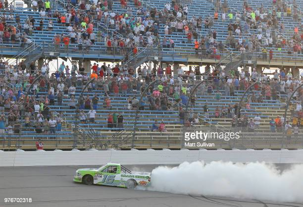 Brett Moffitt driver of the Destiny Homes Toyota celebrates with a burnout after winning the NASCAR Camping World Truck Series MM's 200 presented by...