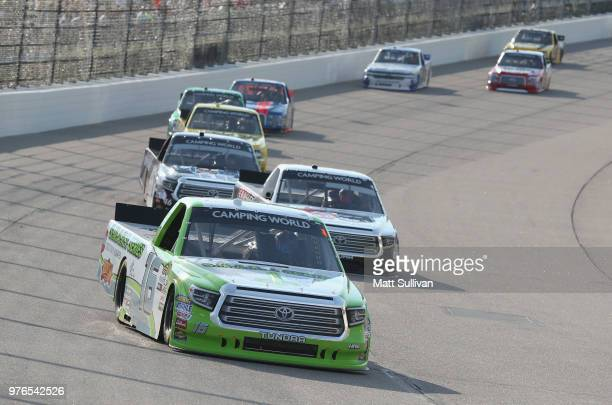 Brett Moffitt driver of the Destiny Homes Toyota leads a pack of trucks during the NASCAR Camping World Truck Series MM's 200 presented by Casey's...