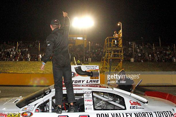 Brett Moffitt driver of the Don Valley North Toyota Dealership Toyota celebrates after winning the NASCAR KN Pro Series East Samuel 150 on July 14...