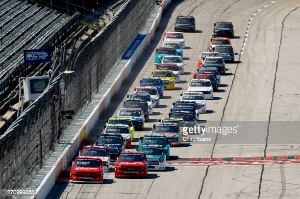 Brett Moffitt, driver of the GMS Fabrication Chevrolet, and Sheldon Creed, driver of the Chevy Accessories Chevrolet, lead the field to start the...