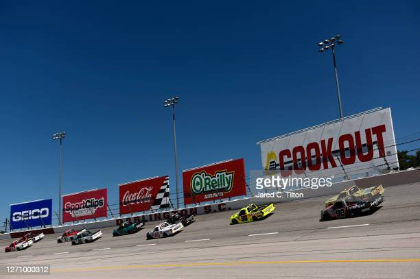 Brett Moffitt, driver of the GMS Fabrication Chevrolet, leads the field during the NASCAR Gander Outdoors Truck Series South Carolina Education...