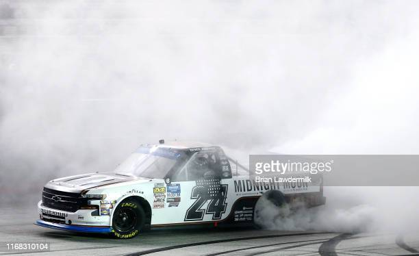 Brett Moffitt, driver of the Midnight Moon Moonshine Chevrolet, celebrate11s after the NASCAR Gander Outdoor Truck Series UNOH 200 presented by Ohio...