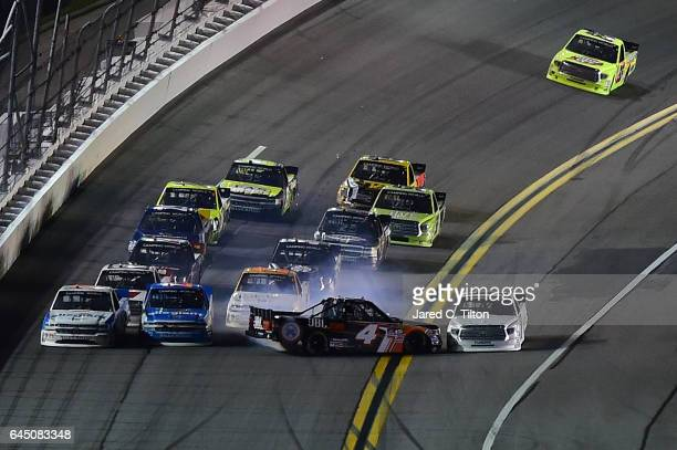 Brett Moffitt driver of the Toyota and Christopher Bell driver of the JBL Toyota spin during the NASCAR Camping World Truck Series NextEra Energy...