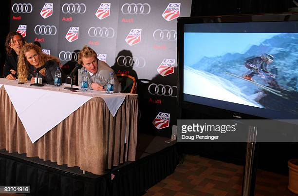 Brett Morgen director of 'Truth In Motion' Sarah Schleper and Ted Ligety of the US Ski Team view the movie trailer as they speak at a press...