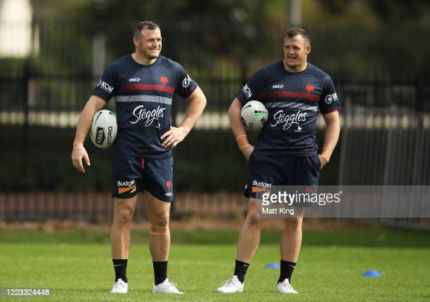 Brett Morris and Josh Morris look on during a Sydney Roosters NRL training session at Kippax Lake Field on May 07 2020 in Sydney Australia