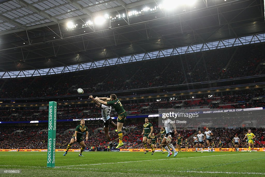 Brett Morris of Australia leaps for a high ball with Marika Koroibete of Fiji during the Rugby League World Cup Semi Final match between Australia and Fiji at Wembley Stadium on November 23, 2013 in London, England.