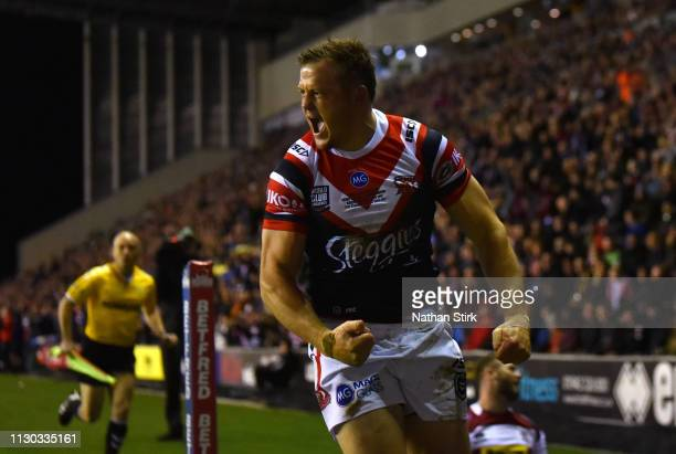 Brett Morris of Sydney Roosters celebrates as he scores their first try during the World Club Challenge match between Wigan Warriors and Sydney...