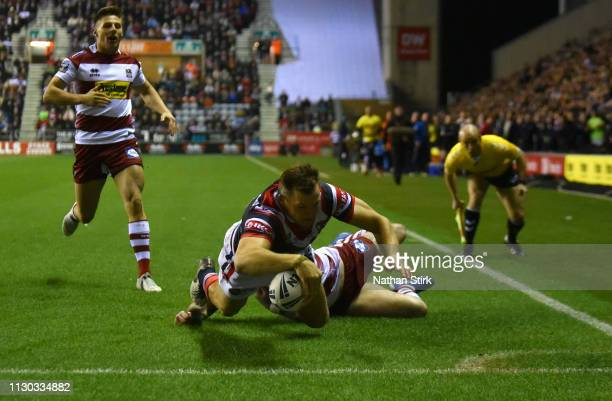 Brett Morris of Sydney Roosters touches down as he scores their first try during the World Club Challenge match between Wigan Warriors and Sydney...
