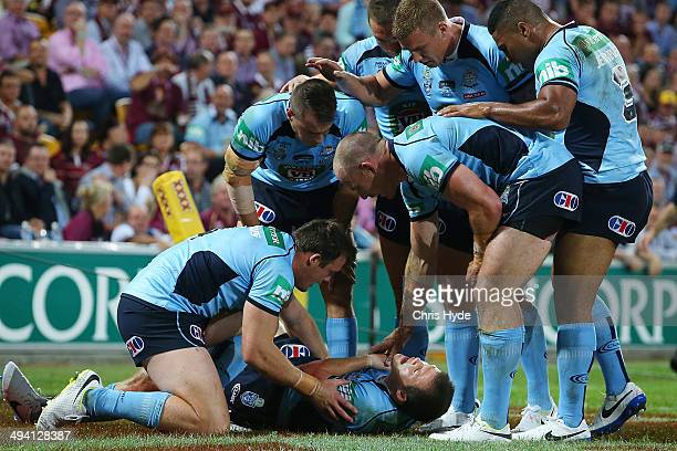 Brett Morris of the Blues is injured after scoring a try during game one of the State of Origin series between the Queensland Maroons and the New...