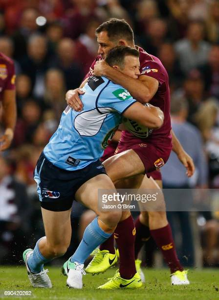 Brett Morris of the Blues is tackled by Cameron Smith during game one of the State Of Origin series between the Queensland Maroons and the New South...