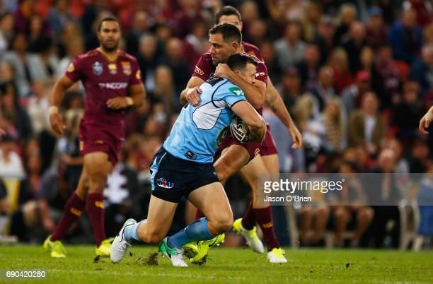 BRISBANE AUSTRALIA Brett Morris of the Blues is tackled by Cameron Smith during game one of the State Of Origin series between the Queensland Maroons...