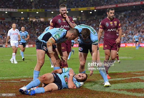Brett Morris of the Blues screams in agony as he injures himself scoring a try during game one of the State of Origin series between the Queensland...