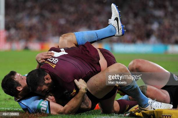 Brett Morris of the Blues tackles Darius Boyd of the Maroons on the try line during game one of the State of Origin series between the Queensland...