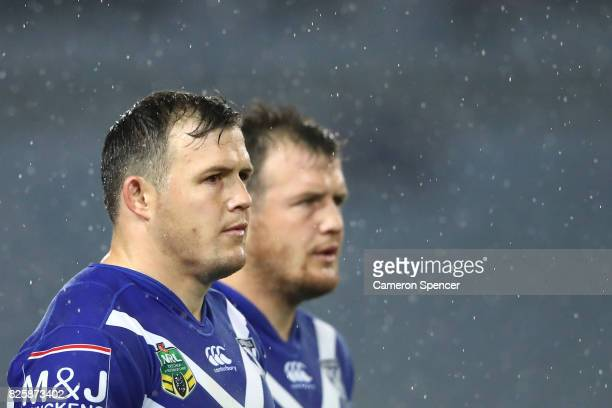 Brett Morris of the Bulldogs and Josh Morris of the Bulldogs look on during the round 22 NRL match between the Canterbury Bulldogs and the Parramatta...
