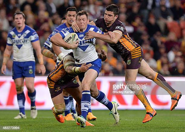 Brett Morris of the Bulldogs attempts to break through the defence during the round 22 NRL match between the Brisbane Broncos and the Canterbury...